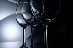 row on crystal wine glasses, dark st