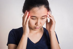 Young woman with hard headache.