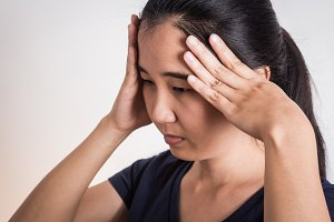 Young woman with hard headache