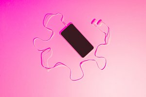 pink toned picture of smartphone wit