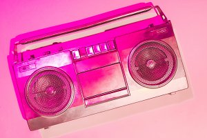 pink toned picture of retro boombox