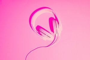 pink toned picture of headphones on