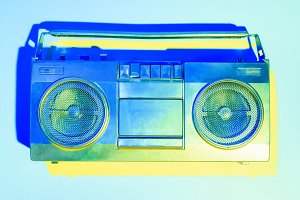 blue toned picture of retro boombox