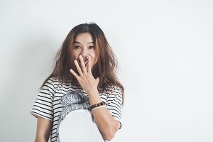Asian woman surprise happy portrait.