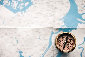 top view of vintage compass on map