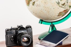 retro film camera with flight ticket