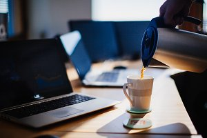 cup of coffee on a desk in an office