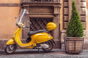 Small old yellow scooter Vespa.
