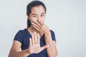 Woman covering her nose and mouth.