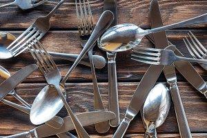 full frame of arranged steel cutlery