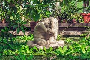 A sculpture of sleeping little girl