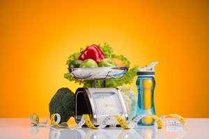 fresh fruits and vegetables on scale