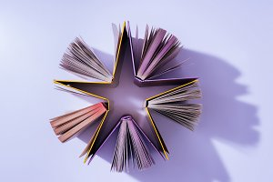top view of stack of books in shape