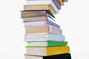 stack of different colored books on