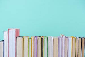 row of different colored books isola