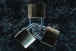 top view of metal locks on dark marb