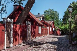 A narrow cobbled street.