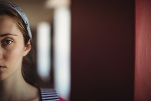 Portrait of schoolgirl in library