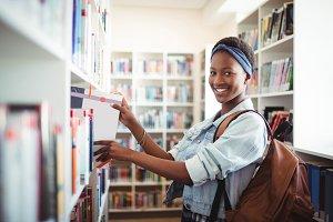 Schoolgirl selecting book