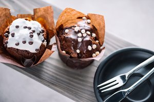 Delicious muffins with glaze and cut