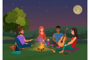 Friends night picnic with bonfire.