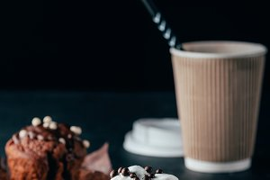 Sweet chocolate muffins with cup of