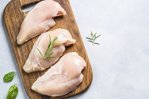 Raw chicken fillet with spices and