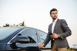 Confident young businessman in suit