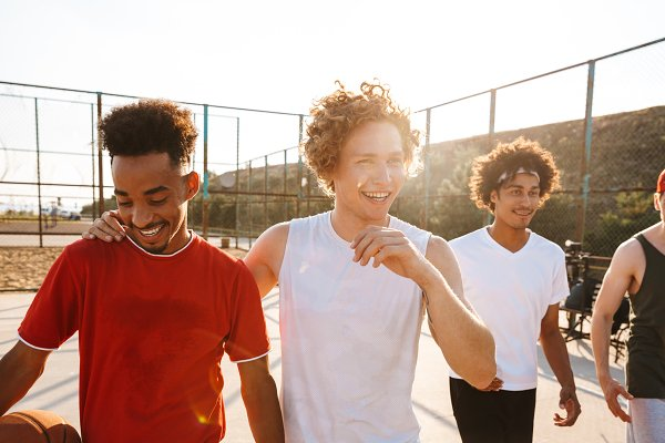Sports Stock Photos: Royalty-free images - Photo of young men smiling while sta