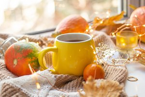 Fall leaves with cup of coffee