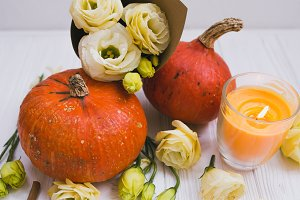 Pumpkins and flowers fall concept