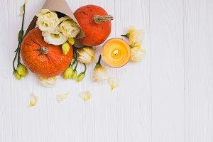 Autumn pumpkin and flowers flat lay