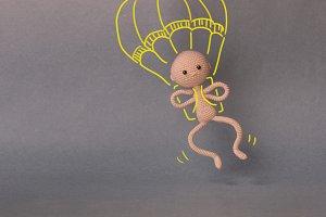 A man flies with a parachute