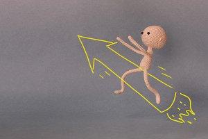 A man flies on a rocket-arrow