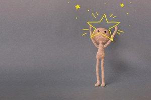 A man holds a big star
