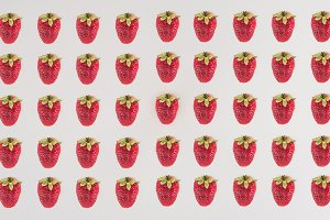 Rows of strawberry isolated on white