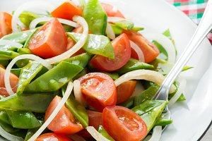 Fresh snow peas and tomato salad