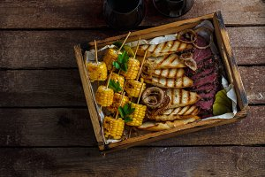 Grilled corn, sliced pastrami and