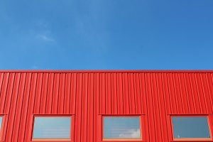 Red building with a blue sky
