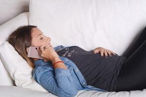 Pregnant woman talking on the phone.