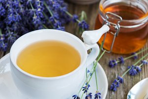 Cup of tea and honey with lavender f