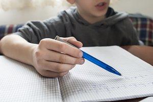 Boy do his homework