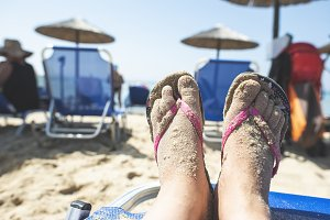 Woman feet on the beach
