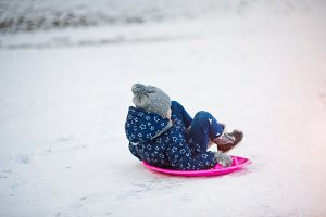 Cute little girl with saucer sleds o