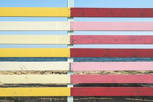 Red and yellow planks on the beach