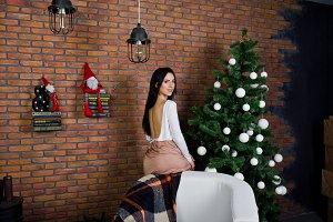 Brunette girl in dress posed near ne