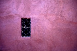A window on a rose wall textures.