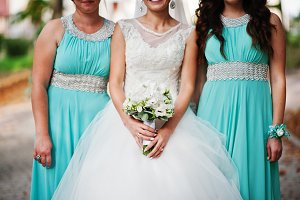 Attractive bride with a bouquet of r