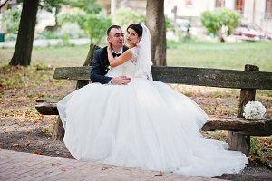 Fantastic wedding couple sitting on