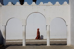 Moroccan person walking on a street